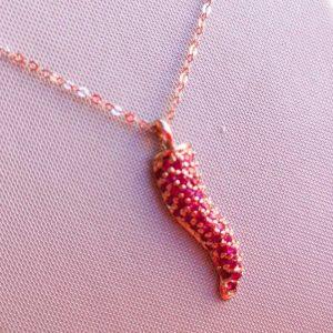 Corno in oro rosa con rubini